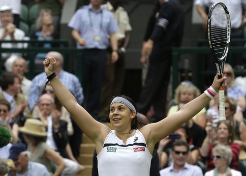 Marion Bartoli of France reacts after beating Kirsten Flipkens of Belgium to win their Women's singles semifinal match at the All England Lawn Tennis Championships in Wimbledon, London, Thursday, July 4, 2013. (AP Photo/Anja Niedringhaus)