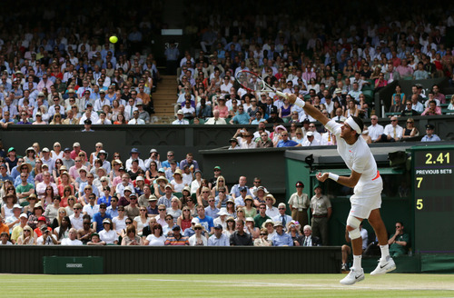 Juan Martin Del Potro of Argentina serves to Novak Djokovic of Serbia during their Men's singles semifinal match at the All England Lawn Tennis Championships in Wimbledon, London, Friday, July 5, 2013.  (AP Photo/Alastair Grant)