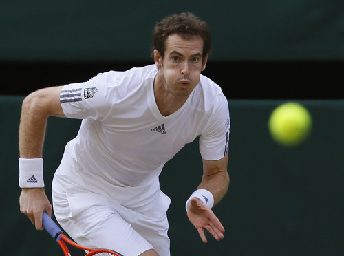 Andy Murray of Britain eyes the ball during his Men's singles semifinal match against Jerzy Janowicz of Poland at the All England Lawn Tennis Championships in Wimbledon, London, Friday, July 5, 2013. (AP Photo/Kirsty Wigglesworth)