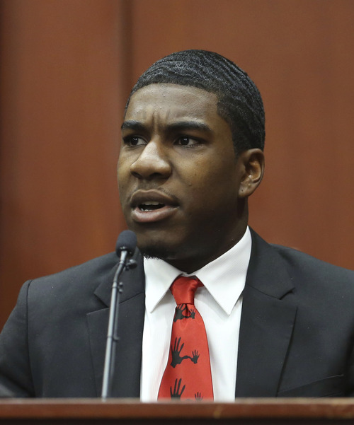Trayvon Martin's brother Jahvaris Fulton takes the stand during George Zimmerman's trial in Seminole County circuit court, Friday, July 5, 2013, in Sanford, Fla. Zimmerman has been charged with second-degree murder for the 2012 shooting death of Trayvon Martin. (AP Photo/Orlando Sentinel, Gary W. Green, Pool)