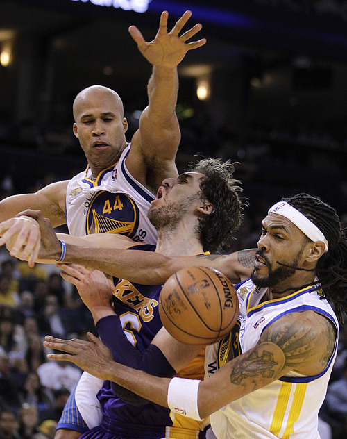 Los Angeles Lakers' Pau Gasol, center, is stripped of the ball by Golden State Warriors' Mikki Moore, right, and Richard Jefferson (44) during the second half of an NBA basketball game Wednesday, April 18, 2012, in Oakland, Calif.  The Warriors won 99-87. (AP Photo/Ben Margot)