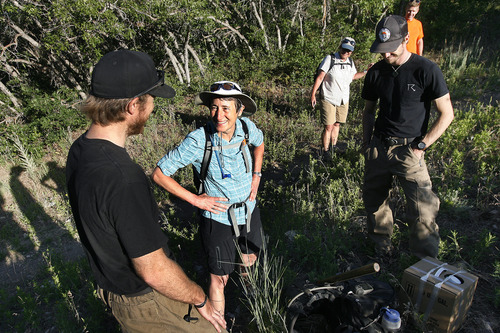 Scott Sommerdorf  |  The Salt Lake Tribune Secretary of Interior Sally Jewell speaks with Hotshots crew members Ethan Hill, left, and Andrew Elkins, right, as she hikes to Barney's Peak in the Oquirrhs with BLM employees, Saturday, June 29, 2013.