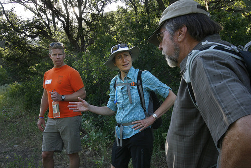 Scott Sommerdorf  |  The Salt Lake Tribune Secretary of Interior Sally Jewell speaks with Brad Washa, left, and Mike Nelson as she hikes to Barney's Peak in the Oquirrhs with BLM employees, Saturday, June 29, 2013.