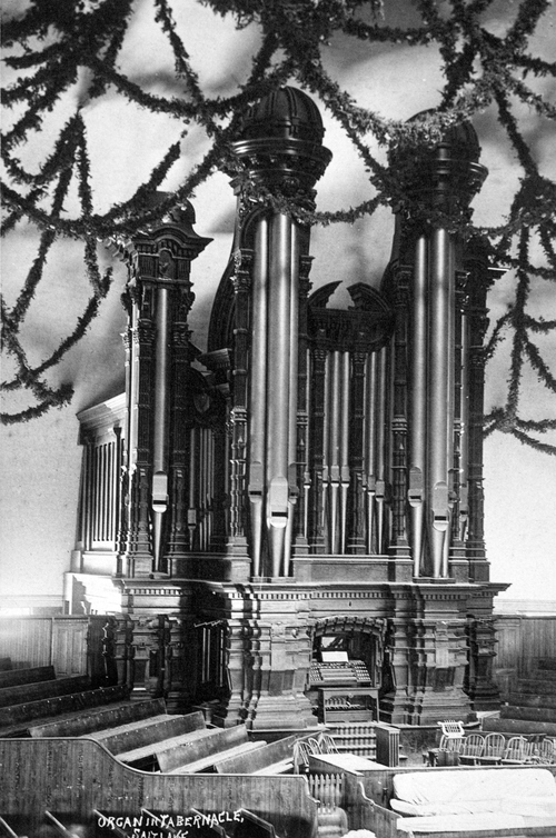 (Salt Lake Tribune archive)  Interior of the Salt Lake Tabernacle shortly after its completion in 1867. The Tabernacle, an engineering marvel, was built between 1864 and 1867. The roof was constructed in an Ithiel Town lattice-truss arch system that is held together by dowels and wedges. The building has a sandstone foundation, and the dome is supported by 44 sandstone piers. The overall seating capacity of the building is 7,000, which includes the choir area and gallery (balcony).