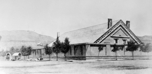 (Salt Lake Tribune archive)  A rare photo of the original tabernacle built in Salt Lake in 1851. a Behind it is a series of open-sided boweries which were erected only weeks after the pioneers arrived. With wood posts supporting a roof made of leafy boughs and dirt, this rough shelter provided some protection for religious worship and other public gatherings.