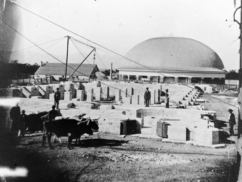 (Salt Lake Tribune archive)  Granite blocks to be used to build the Salt Lake Temple sit near the Salt Lake Tabernacle shortly after its completion  in 1867.