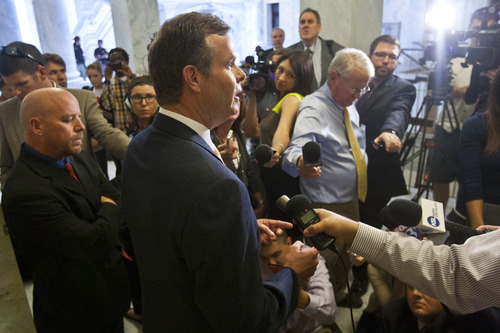 Chris Detrick  |  Tribune file photo Attorney General John Swallow talks to members of the media outside of his office at the Utah State Capitol on June 19 after the House Republican Caucus voted to create a special committee to investigate allegations against him.