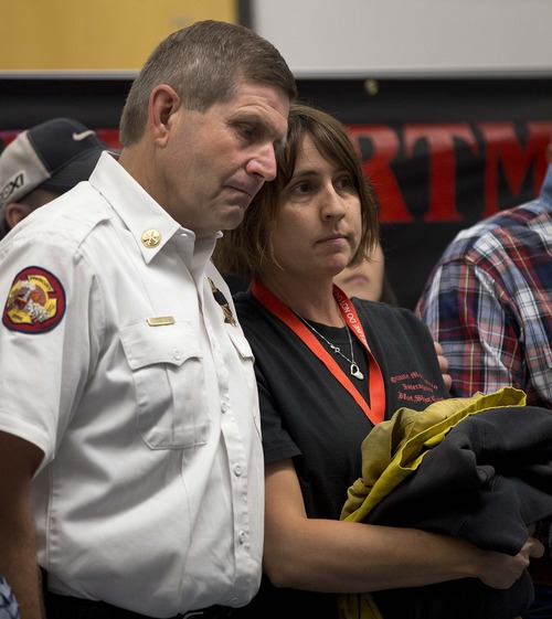 Amanda Marsh, right, widow of Granite Mountain Hotshot Crew superintendent Eric Marsh, and Prescott Fire Chief Darrel Willis, wait to speak at a news conference, Thursday, July 4, 2013 in Prescott, Ariz. Eric Marsh, who founded the Granite Mountain Hotshots, was one of the 19 Hotshot firefighters who were killed by an out-of-control blaze on Sunday near Yarnell, Ariz. (AP Photo/Julie Jacobson)