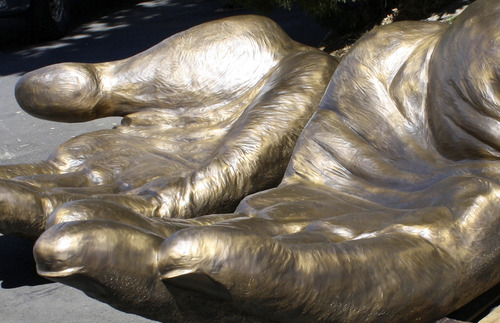 "| Courtesy Park City artist Greg Ragland created a bronze sculpture entitled, ""To serve and protect"" for the plaza garden of the new public safety building in Salt Lake City."