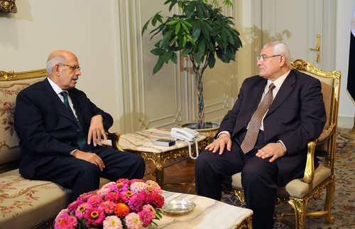 This image released by the office of the Egyptian Presidency on Saturday, July 6, 2013 shows newly-appointed interim Prime Minister Mohamed Elbaradei, left, meeting with interim president Adly Mansour, right, at the presidential palace. Egypt's new president moved to assert his authority Saturday by naming a chief rival of ousted leader Mohammed Morsi as interim prime minister and holding crisis talks with security officials on efforts to reclaim control of the streets.(AP Photo/Egyptian Presidency)