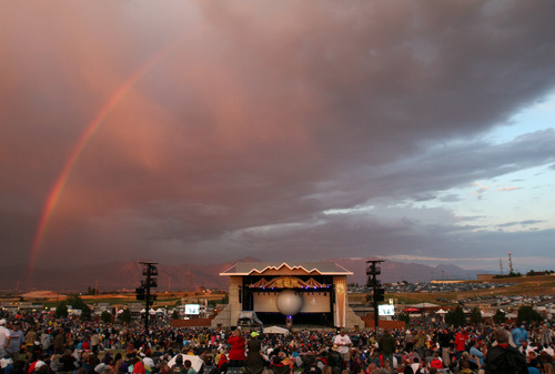 Rick Egan  | The Salt Lake Tribune   A rainbow behind the Man in the Moon stage at USANA, Saturday, July 6, 2013.