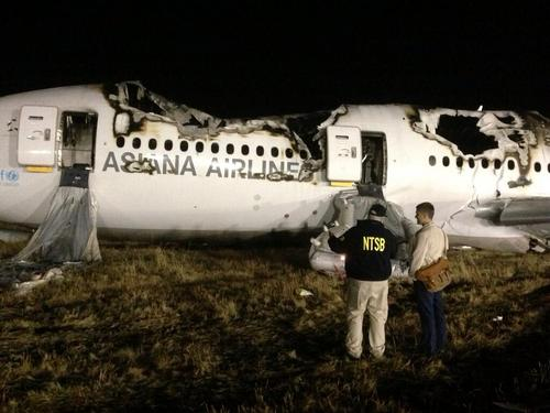 In this photo provided by the National Transportation Security Board (NTSB), NTSB investigators conduct a first site assessment overnight of the Asiana Airlines flight 214 that crashed at the San Francisco International Airport in San Francisco, Saturday, July 6, 2013. The Asiana Airlines Boeing 777 crashed while landing after a likely 10-hour-plus flight from Seoul, South Korea. The flight originated in Shanghai and stopped in Seoul before the long trek to San Francisco. (AP Photo/NTSB)