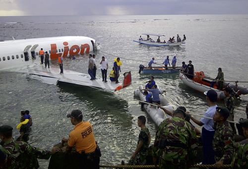 FILE - In this Saturday, April 13, 2013, file photo, released by Indonesia's National Rescue Team rescuers arrive at the crash site of a Lion Air plane in Bali, Indonesia. The plane carrying more than 100 passengers and crew overshot a runway on the Indonesian resort island of Bali on Saturday and crashed into the sea, injuring nearly two dozen people, officials said. (AP Photo/National Rescue Team, File)