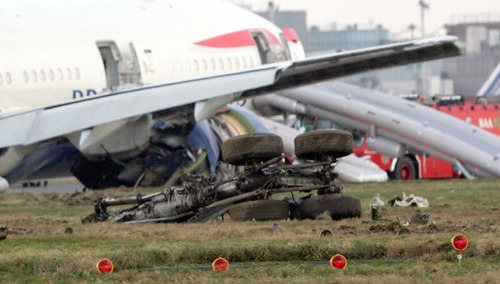 FILE -This Thursday Jan. 17, 2008 file photo, shows the undercarriage from a British Airways Boeing 777 plane flying from China that landed short of the runway  at London's Heathrow Airport.  An official report said Thursday Sept 4, 2008, that ice in fuel lines probably caused the  British Airways jet to lose power and make a jarring emergency landing in London in January. (AP Photo/Tom Hevezi)