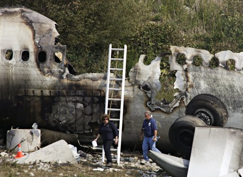 FILE - In this Wednesday Aug. 3, 2005, file photo, crash investigators examine the wreckage of Air France flight 358 at Pearson Airport in Toronto.  All 309 people on the Airbus A340 survived. (AP Photo/The Canadian Press, Frank Gunn)