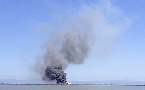 In this photo provided by Scott Sobczak, smoke rises from of Asiana Flight 214 after it crashed at San Francisco International Airport in San Francisco, Saturday, July 6, 2013. (AP Photo/Scott Sobczak) MANDATORY CREDIT