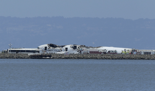 The wreckage of Asiana Flight 214 is seen after it crashed at San Francisco International Airport in San Francisco, Saturday, July 6, 2013. (AP Photo/Jeff Chiu)
