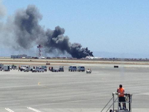 This photo provided by Krista Seiden shows smoke rising from what a federal aviation official says was an Asiana Airlines flight crashing while landing at San Francisco airport on Saturday, July 6, 2013. (AP Photo/Krista Seiden)