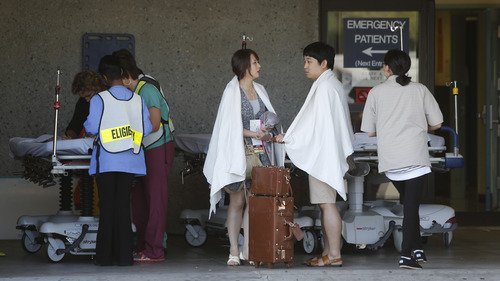 Passengers from Asiana Flight 214 are treated at San Francisco General Hospital after the plane crashed at San Francisco International Airport in San Francisco, Saturday, July 6, 2013. (AP Photo/Bay Area News Group, John Green)