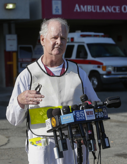 Dr. Chris Barton, Chief of Emergency Services at San Francisco General Hospital, speaks to reporters about passengers from Asiana Flight 214 that crashed at San Francisco International Airport in San Francisco, Saturday, July 6, 2013. (AP Photo/Bay Area News Group, John Green)