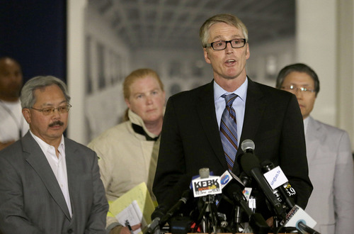 David Johnson, FBI special agent in charge of the San Francisco Division, foreground, speaks in front of Mayor Ed Lee, from left, Fire Chief Joanne Hayes-White, and Korean Consulate of San Francisco Dongman Han at a news conference after Asiana Flight 214 crashed at San Francisco International Airport in San Francisco, Saturday, July 6, 2013. (AP Photo/Jeff Chiu)