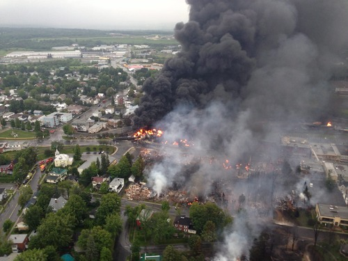 An aerial view of a fire in the town of Lac-Megantic is seen from a Sûreté du Québec helicopter Saturday, July 6, 2014 following a train derailment the sparked several explosions in Lac Megantic, Quebec. (AP Photo/Sûreté du Québec via The Canadian Press)