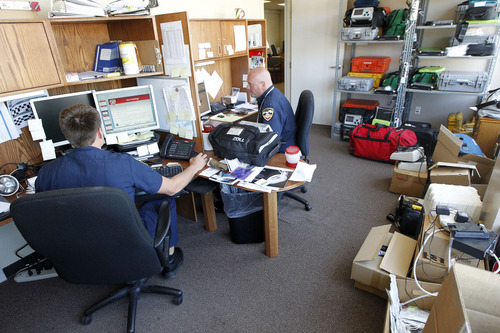 Paramedics share an office with their equipment in the old Salt Lake Public Safety Building at 315 E. 200 South. The new facility will help allieviate that problem.