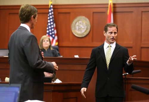 Adam Pollock, right, a central Florida gym owner and trainer, addresses the jury during a demonstration with defense attorney Mark O'Mara, left, during the George Zimmerman trial in Seminole Circuit Court, in Sanford, Fla., Monday, July  8, 2013. Zimmerman is charged with second-degree murder in the fatal shooting of Trayvon Martin, an unarmed teen, in 2012. (AP Photo/Orlando Sentinel, Joe Burbank, Pool)