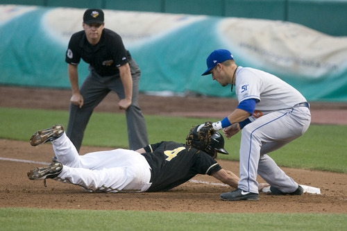 Rick Egan  | The Salt Lake Tribune   Drew Heid (4) dives back to first for the Bees and beats the tag by Zach Lutz (19) Las Vegas,  in Pacific Coast League action against the Las Vegas 51s, Monday, July 8, 2013.
