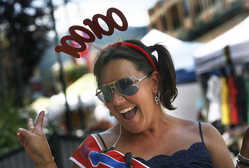 """Scott Sommerdorf     The Salt Lake Tribune Michelle McDonald is one of the """"Silly Staff"""" at the Park Silly Market, Sunday, July 7, 2013. For some businesses the Park Silly Sunday Market is a chance to try out their products and see if the public likes it. The Park Silly Sunday Market is celebrating its fifth season and 100th market on Historic Main Street."""