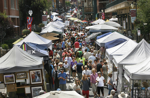 Scott Sommerdorf     The Salt Lake Tribune Main Street was packed with shoppers at the Park Silly Market, Sunday, July 7, 2013. For some businesses the Park Silly Sunday Market is a chance to try out their products and see if the public likes it. The Park Silly Sunday Market is celebrating its fifth season and 100th market on Historic Main Street.