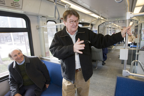 Al Hartmann  |  Tribune file photo John Inglish, standing, received a $22,700 bonus last year on top of the previous year's $364,000 total compensation for his position as CEO of the Utah Transit Authority. Since leaving the agency in April 2012, he has begun drawing a $200,000 annual pension. UTA General Manager Mike Allegra, seated, received a bonus last year of $25,000.