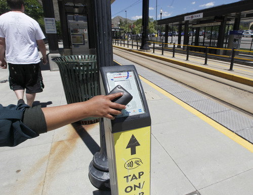 "Al Hartmann |  The Salt Lake Tribune University of Utah student taps on to ride the TRAX train at University Station Wednesday June 5.   A quarter of UTA pass holders do not ""tap off"" after they ""tap on."" It wreaks havoc with planning, because it doesn't allow UTA to gather full data about where people travel."