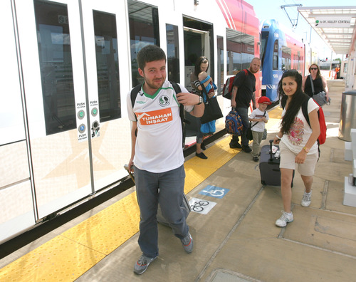 Rick Egan  | The Salt Lake Tribune    Ercon Yavoz, and Elif Dilsiz, Istanbul Turkey, ride the train to the Salt Lake International Airport on the green line, Thursday, June 13, 2013.