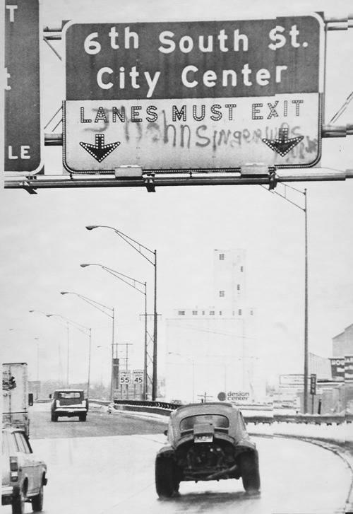 "Tribune file photo  In this 1979 photo, an overpass sign on the outskirts of Salt Lake City shows graffiti saying, ""John Singer was murdered."" Singer was shot when he aimed  gun at uniformed officers who were attempting to arrest him on a contempt of court charge."