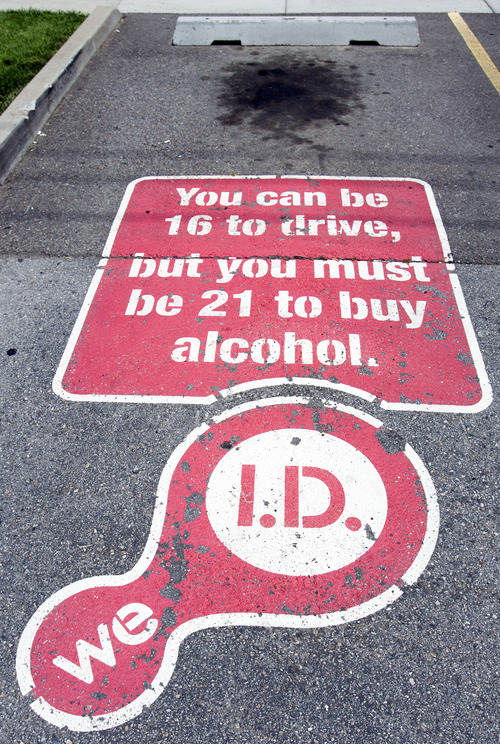 Steve Griffin | The Salt Lake Tribune   Warning signs are painted on some of the parking spaces at the Liquor and Wine Store near 1200 west and North Temple in Salt Lake City , Utah Monday July 8, 2013.