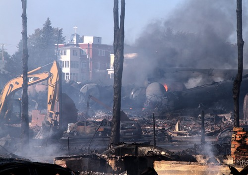 In a Monday, July 8, 2013 photo provided by Surete du Quebec via The Canadian Press, the downtown core lies in ruins in Lac-Megantic, Quebec, in a Surete du Quebec. Thirteen people are confirmed dead and forty more are listed as missing after a train derailed ignited tanker cars carrying crude oil.  (AP Photo/Surete du Quebec via The Canadian Press)