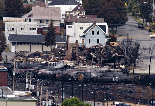 Charred tanker cars are piled up in Lac-Megantic, Quebec, Tuesday, July 9, 2013.   Investigators are looking for the cause of the fiery oil train derailment Saturday that led to the explosions that killed at least 13 people. (AP Photo/THE CANADIAN PRESS,Jacques Boissinot )