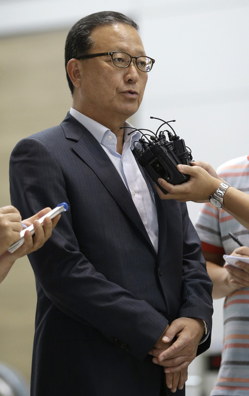 Asiana Airlines President and CEO Yoon Young-doo answers reporters' questions before heading to San Francisco at the flight gate of the Incheon International Airport in Incheon, west of Seoul, South Korea, Tuesday, July 9, 2013. A South Korean official says both U.S. and Korean investigators have been interviewing the pilots who were in the cockpit when an Asiana Airlines plane clipped a seawall before crash landing at San Francisco International Airport Saturday.(AP Photo/Lee Jin-man, Pool)