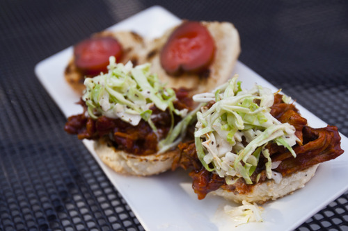 Chris Detrick  |  The Salt Lake Tribune House-smoked pulled pork sliders topped with slaw and koolickle ($7) sat Cucina Deli, 1026 2nd Ave in Salt Lake City, Friday July 5, 2013.
