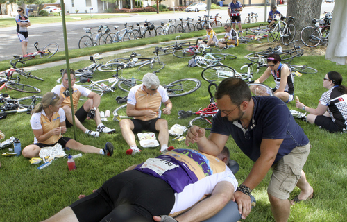 Keith Johnson | The Salt Lake Tribune  Justin Tanner gives Kevin Larsen a massage at Lewiston Park during the MS 150 bike ride through Cache Valley, Utah June 29, 2013.