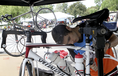 Keith Johnson | The Salt Lake Tribune  Ian Crossett with Bingham Cyclery makes repairs on a bicycle at Lewiston Park during the MS 150 bike ride in Cache Valley, Utah June 29, 2013.