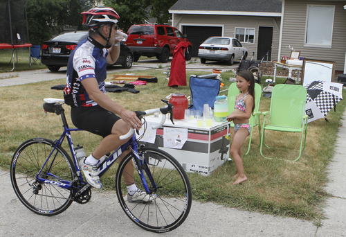 Keith Johnson | The Salt Lake Tribune  Gordon Garrett stops to buy a cup of lemonade from Sierra Hernandez in Lewiston, Utah during the MS 150 bike ride through Cache Valley, Utah June 29, 2013.