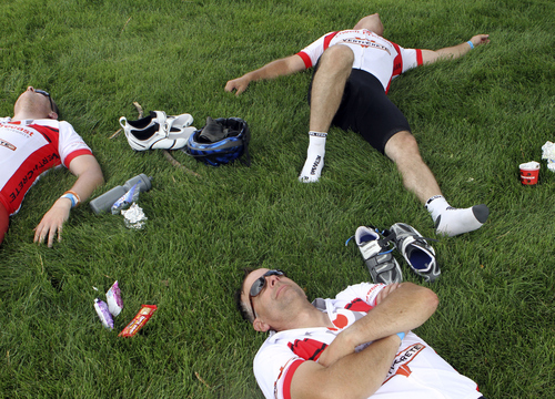 Keith Johnson | The Salt Lake Tribune  Todd Berg, bottom, Nate Parry, left, and Butch Baker rest in the shade after stopping for a quick lunch at Lewiston, Utah during the MS 150 bike ride June 29, 2013.