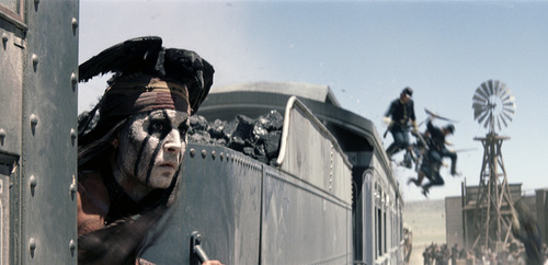 """FILE - This undated file photo provided by Disney shows Johnny Depp as Tonto in a scene from """"The Lone Ranger."""" Domestic box office numbers so far on this long Fourth of July holiday weekend are suggesting the highly anticipated, $250 million Western extravaganza is in serious danger of becoming the train wreck of the summer movie season. The animated minions of family favorite """"Despicable Me 2,"""" with a price tag one third of what """"The Lone Ranger"""" cost to make, is outperforming the masked man by more than three to one. (AP Photo/Disney Enterprises, Inc.)"""