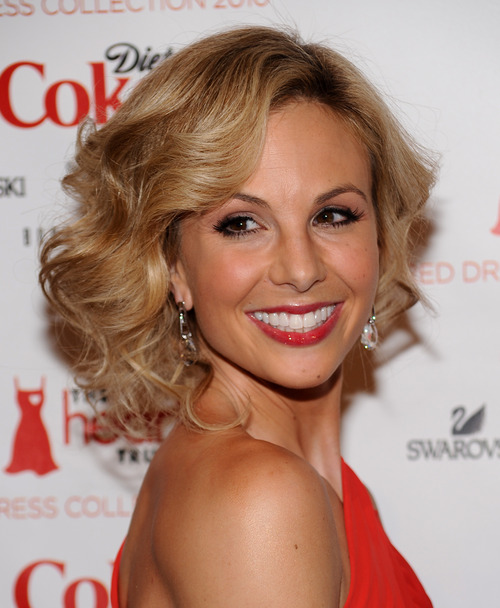 """FILE - In this Feb. 11, 2010 file photo, television personality Elisabeth Hasselbeck arrives at The Heart Truth's Red Dress Collection 2010 fashion show in New York. Hasselbeck is leaving the desk at """"The View"""" for the couch on Fox News Channel's """"Fox & Friends."""" The news network said Tuesday, July 9, 2013, that Hasselbeck, who has been on Barbara Walters' syndicated daytime show for a decade, will join co-anchors Steve Doocy and Brian Kilmeade on Fox's morning show in September. (AP Photo/Evan Agostini, File)"""
