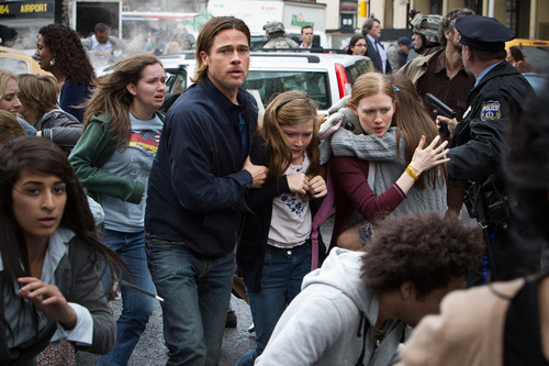 """This publicity image released by Paramount Pictures shows, from center left, Brad Pitt as Gerry Lane, Abigail Hargrove as Rachel Lane, and Mireille Enos as Karin Lanein a scene from """"World War Z."""" (AP Photo/Paramount Pictures, Jaap Buitendijk)"""