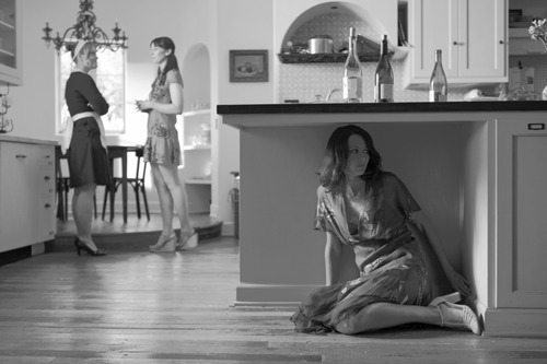 """Beatrice (Amy Acker, right) overhears a conversation between the maid Margaret (Ashley Johnson, left) and Hero (Jillian Morgese) in """"Much Ado About Nothing,"""" Joss Whedon's modern-dress adaptation of the Shakespeare comedy. Elsa Guillet-Chapuis  