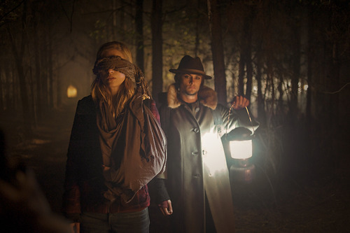 """Luca (Shiloh Fernandez, right) leads Jane (Brit Marling), a corporate spy infiltrating a radical environmental group, through the woods in the thriller """"The East."""" Myles Aronowitz  