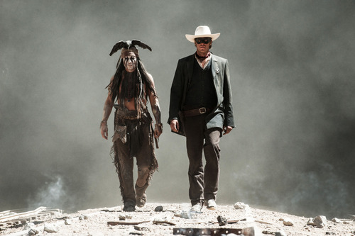 """This undated publicity photo released by Disney and Jerry Bruckheimer, Inc. shows Johnny Depp, left, as Tonto, and Armie Hammer, as The Lone Ranger, in a scene from the film, """"The Lone Ranger.""""  (AP Photo/Disney/Jerry Bruckheimer, Inc., Peter Mountain, File)"""